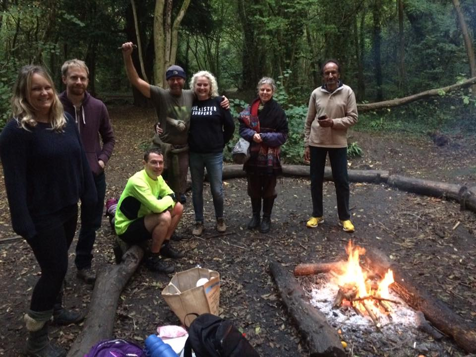 Friends of Stoke Park gather around the camp fire